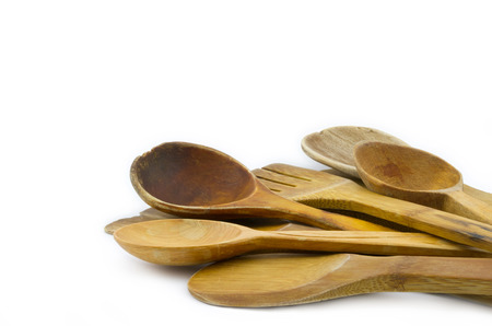 stirrer: Group of different old used wooden spoons isolated on white background