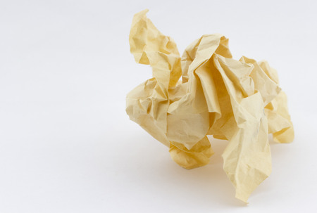 yellowed: Old yellowed crumpled paper on white background with place for your text