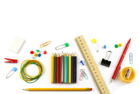 School supplies: colored pencils wooden yardstick erasers binders stationery gum paper clips pencil sharpener a small clothespin colored pins pencil and pen isolated on white background Stock Photo
