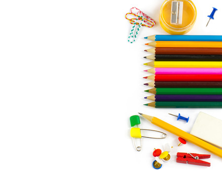 School supplies: colored pencils paper clips pencil sharpener stationery gum small clothespin colored pins pencil isolated on white background photo