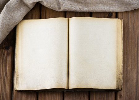 bible background: Top view of blank old book with vintage pages and sackcloth on wooden table