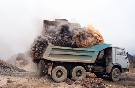 dump truck: Shown indirectly and air pollution.