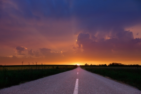 Endless driving on country road at sunset. photo