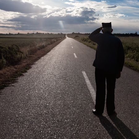 Elderly man looking into the distance along the road Stock Photo
