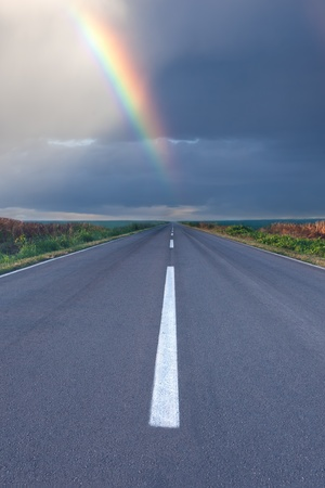 Hope on the road in form of rainbow photo