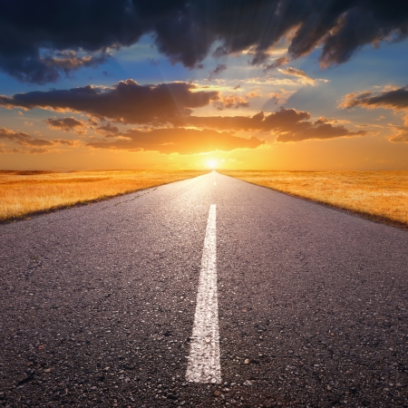 end of road: Empty asphalt road at sunset Stock Photo