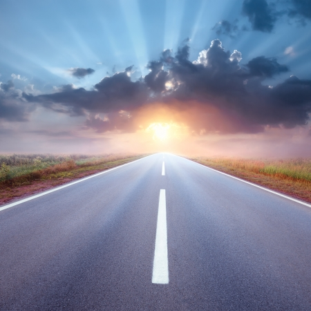 end of road: Driving on an empty asphalt road to the rising sun