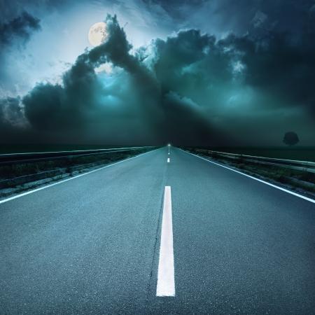 back roads: Driving on asphalt road at spooky night