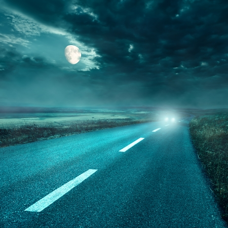 Driving on an empty asphalt road at night Foto de archivo