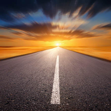 end of road: Blurred empty asphalt road at sunset Stock Photo