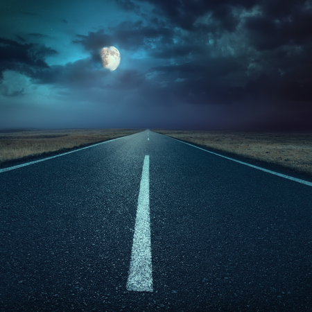 back roads: Driving on an empty asphalt road at night Stock Photo