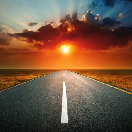 end of the line: an empty highway against the setting sun
