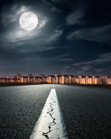 Empty road. Entry into the city on the night of full moon photo
