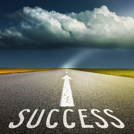 Empty asphalt road towards the big cloud and signs symbolizing success and safety photo