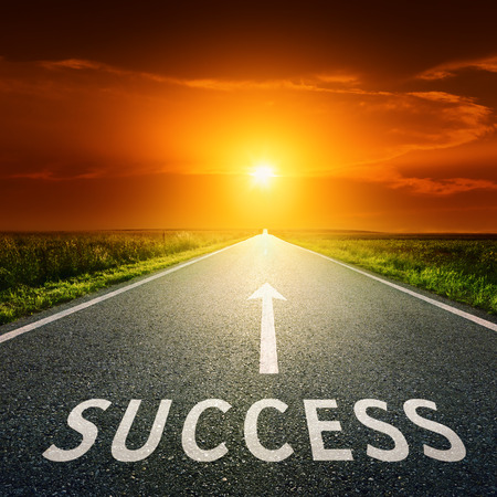 back roads: Empty asphalt road towards the sun and sign symbolizing success  Stock Photo