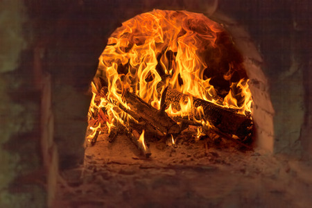 Fire and flames - Firewood burning in old brick furnace