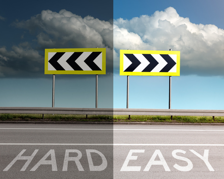 turn sign: Concept on the road, a decision of hard or easy way