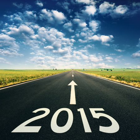 Forward to 2015 new year. Concept on empty, open road on idyllic day photo