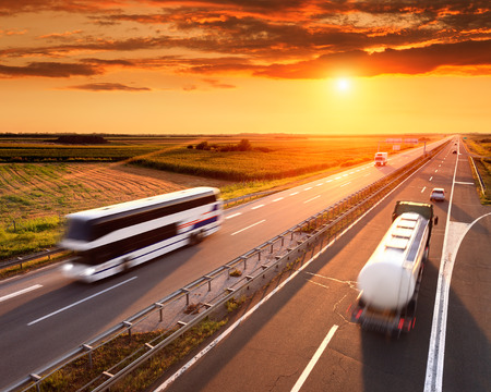 Bus and truck in motion blur on the highway at sunset Stock fotó - 31281988