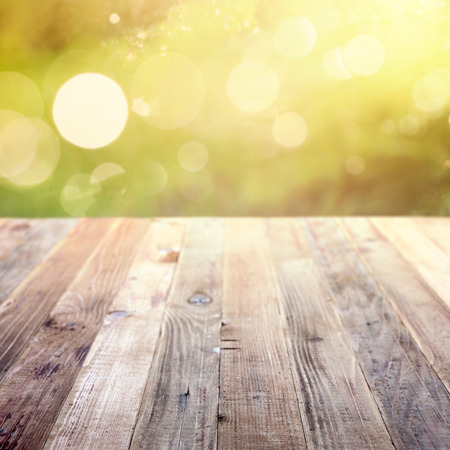 the nature of sunlight: Spring vintage template background with copy space and beautiful natural bokeh. Rustic wooden table in garden  Stock Photo
