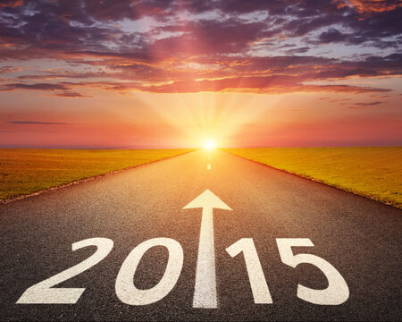 new beginnings: Driving on an empty road at sunset to upcoming 2015