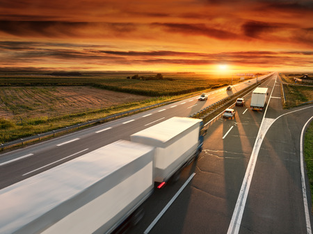 Truck in motion blur on the highway at sunset