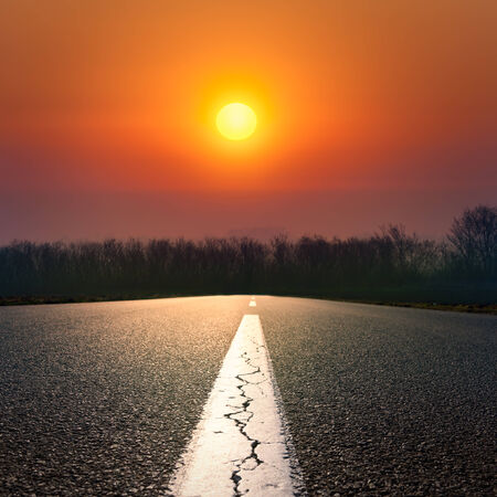 yelloow: Driving on an empty road against the setting sun