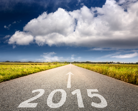 and in direction: Driving on an empty road towards the big cloud to upcoming 2015 Stock Photo