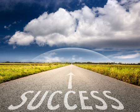 Empty asphalt road towards the big cloud and sphere with sign on asphalt which symbolizing success photo