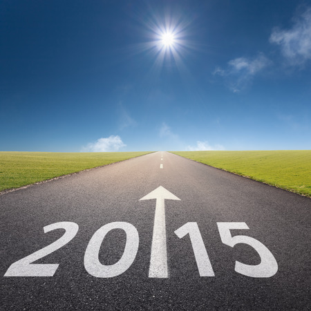 vastness: Driving on an empty road forward to New Year at idyllic sunny day - concept for success