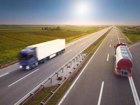 Two trucks in motion blur on highway at idyllic sunny day near Belgrade - Serbia