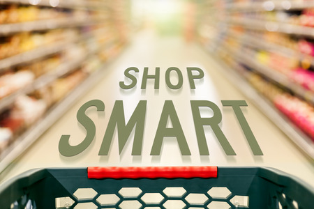 Shopping concept in supermarket for fast consumer lifestyle with the text that advises shop smart. Imagens