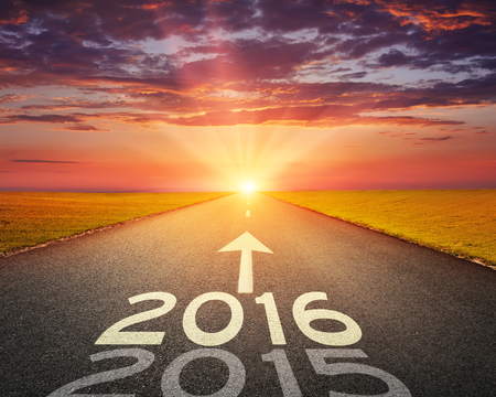 Driving on an empty road towards the setting sun to upcoming 2016 and leaving behind old 2015.