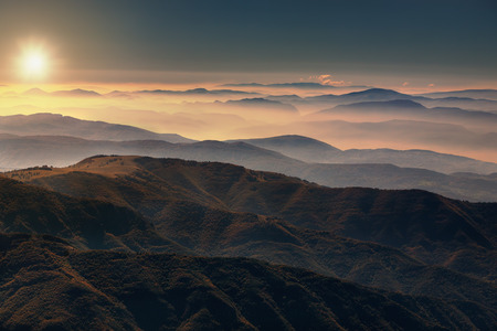 View from the mountain Stara Planina in Serbia at idyllic sunrise above the clouds.
