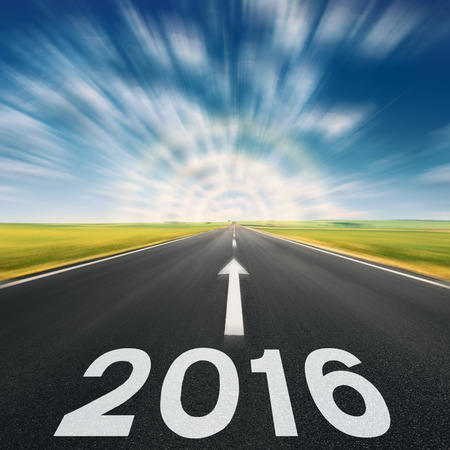 Driving speed on an empty road in blurred motion at lovely sunny day to meet the new 2016 year. Imagens