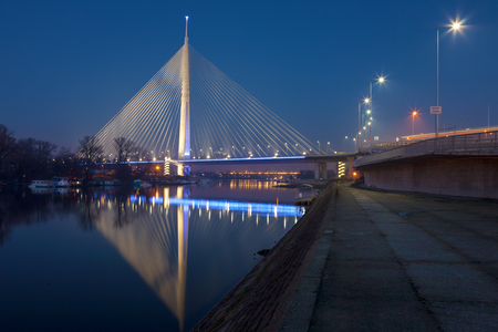 Cable-stayed bridge with one pylon at night. Belgrade, Serbia