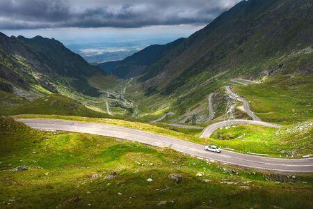 drive car: Driving on winding asphalt road through mountain area at summer. Tranfagarasan road, Romania.
