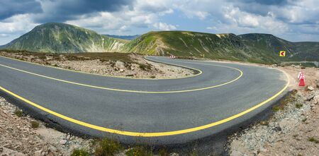 vastness: Driving on an empty alpine road through the mountain vastness. Transalpina road in Parang mountains, Romania. Stock Photo