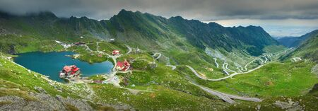 balea: High resolution panorama of Transfagarasan highway which crosses Fagaras mountain range at 2,034 meters altitude with Balea glacier lake in Carpathian mountains, Romania.