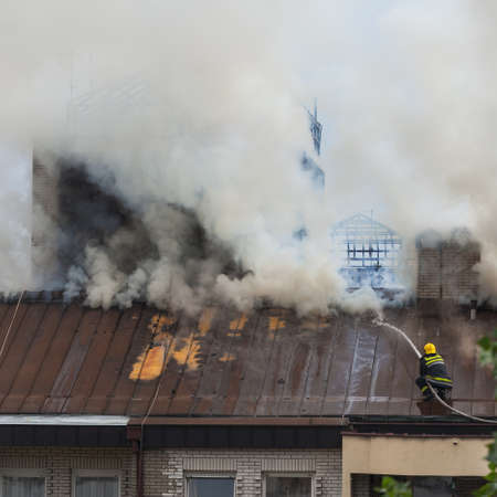 building on fire: Fire fighting in reality on the roof of eight floor building, which lasted up to eight hours with six teams of firefighters on the field.