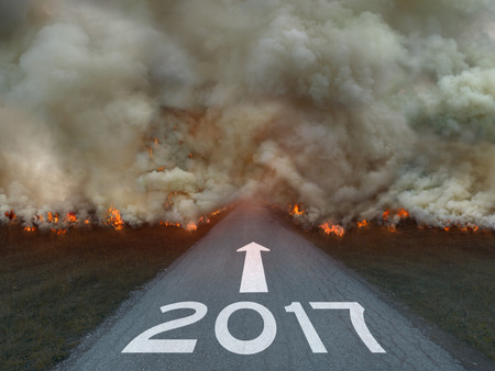 hard way: Driving on an empty road to the dangerous future and to upcoming new 2017 year. Concept for success. Stock Photo