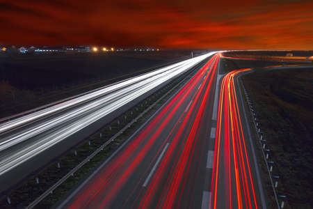 Driving on highway at night near Belgrade - Serbia. Llight trails on motorway at night, long exposure abstract photograph.