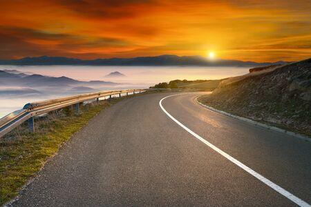 mountain sunset: Winding mountain road against the sun in early morning. Mountain Golija, Serbia.