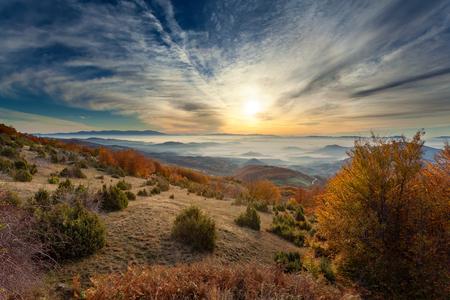 Idyllic autumn scenery on Golija mountain in Serbia at beautiful sunrise and sun in background.