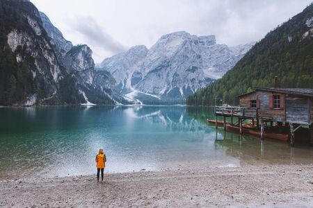 tranquil: Young woman watching the tranquil morning scene at lake Braies - Dolomites mountain range, Italy.  Stock Photo