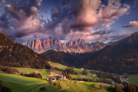 odle: Idyllic landscape of village Santa Maddalena with a view on Geisler or Odle high mountain peaks - Dolomites, Italy.
