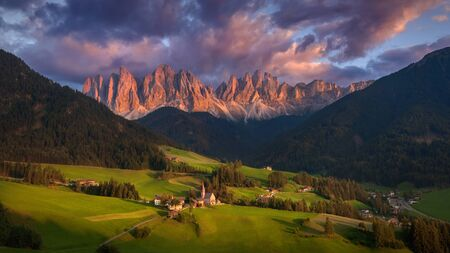 odle: Beautiful scenery of village Santa Maddalena with a view on Geisler or Odle high mountain peaks - Dolomites, Italy.