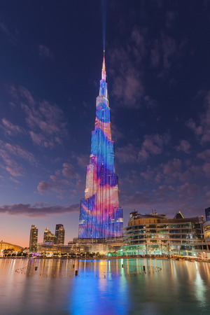 Laser and light show at the Burj Khalifa highest building on the world with reflections in Dubai fountain. Editorial