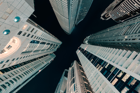 Upward night view on high residentials towers at fastest growing city in the world. Dubai, UAE. Stock fotó