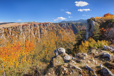 Hidden natural beauty in colorful autumn scenery at idyllic sunny day in wild canyon of river Susuica, Montenegro.